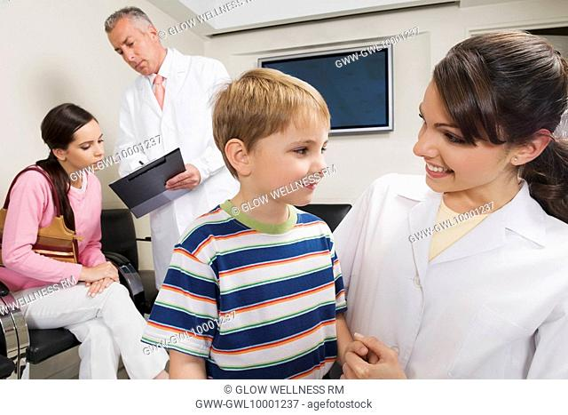 Male and a female doctor with patients