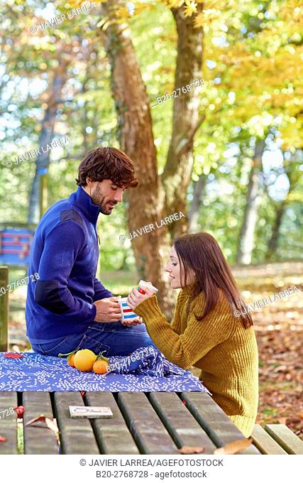 Couple picnic in the forest, Autumn, Pagoetako Parke Naturala, Pagoeta Natural Park, Aya, Gipuzkoa, Basque Country, Spain