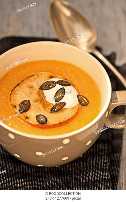 Apple and potato soup with pumpkin seeds