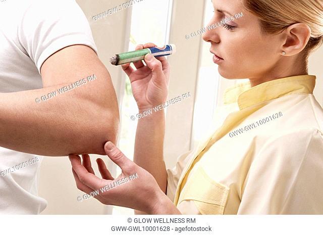 Man receiving moxibustion treatment