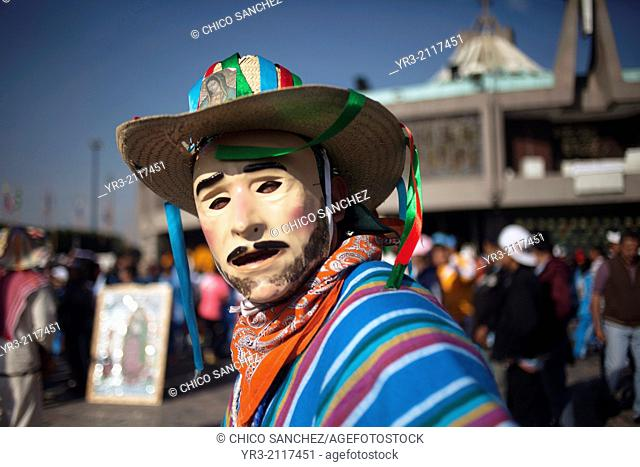 A dancer wearing a mask, from Los Altos, Veracruz, performs the Danza de San Juan at the pilgrimage to Our Lady of Guadalupe Basilica in Mexico City, Mexico