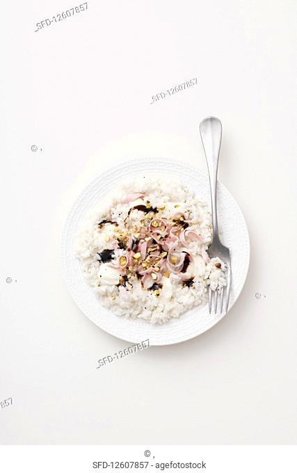 Risotto with mortadella, pistachios and crescenza