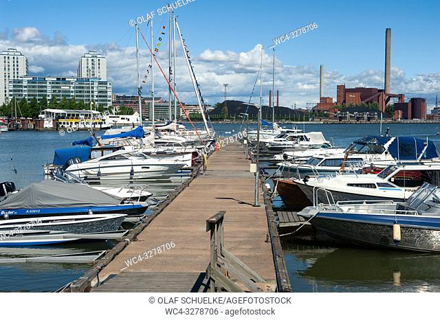Helsinki, Finland, Europe - Boats at a jetty in the Finnish capital with apartment buildings in the backdrop