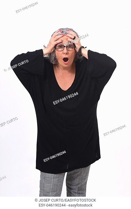 woman with expression of forgetfulness or surprise on white background
