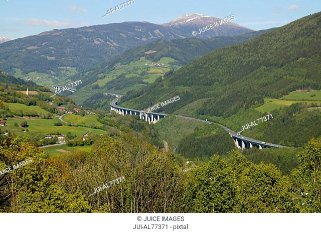 Aerial view of Tauern-motorway winding through rural valley, Gmuend, Kaernten, Austria