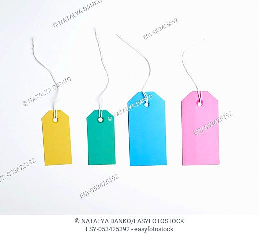 colored paper tags on a white rope, white background, close up