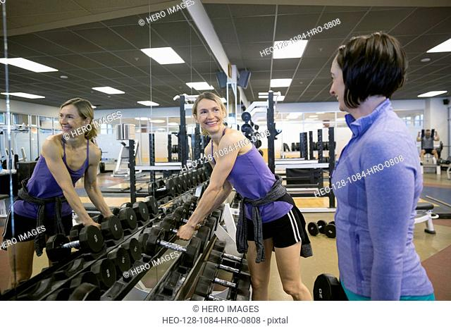 Women weight lifting at gym
