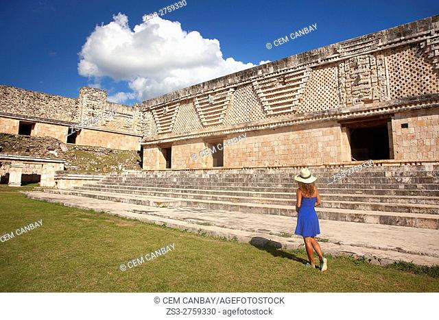 Woman in front of the Quadrangle Of The Nuns in Uxmal Ruins, Uxmal, Yucatan Province, Mexico, Central America