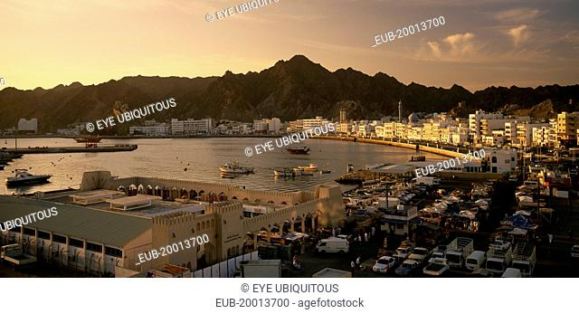 View of Mutrah area of Muscat including harbour and Mutrah Souk in the foreground