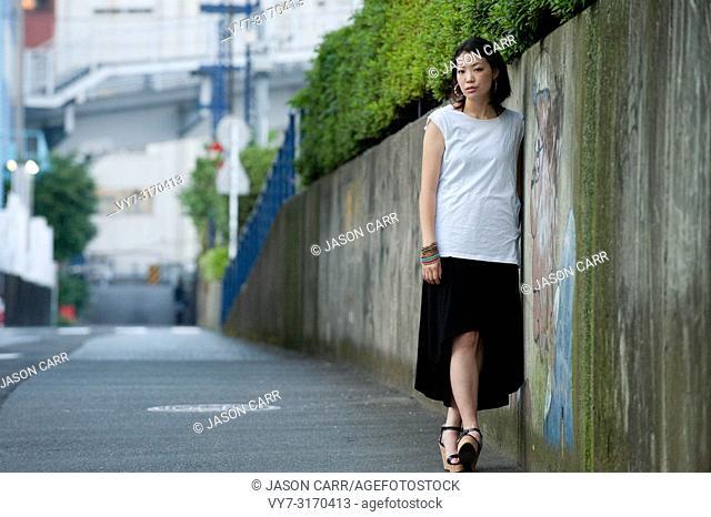 Japanese Girl poses on the street in Yokohama, Japan