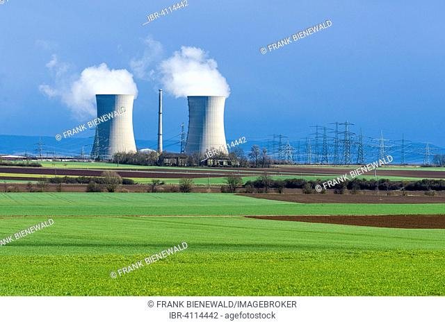 Grafenrheinfeld nuclear power plant, steam coming out of the cooling towers against a dark sky, Grafenrheinfeld, Bavaria, Germany