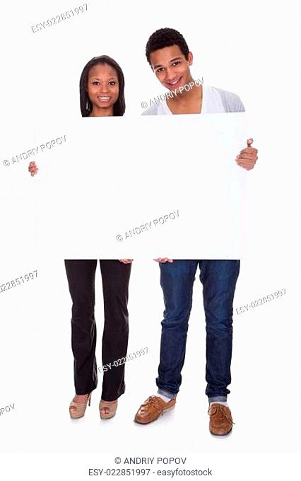 Young Couple Holding Placard
