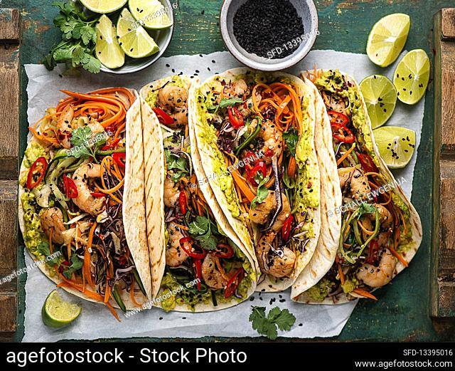 Crispy prawn tacos with vegetables