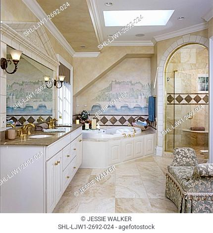 BATHROOMS: Master Bathroom. Beige, white, and tan colors, vanity, whirl pool bath, glass shower stall, brass fixtures, skylight, painted murals
