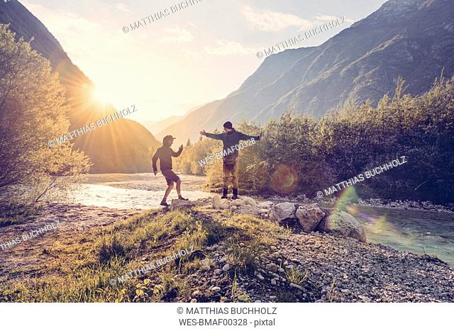 Slovenia, Bovec, two men at Soca river