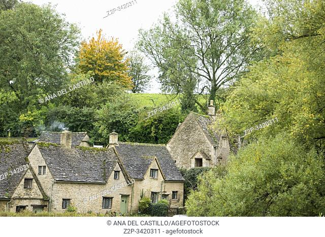 Traditional Cotswold cottages in England, UK. Bibury is a village and civil parish in Gloucestershire, England on October 13, 2019. Arlington row