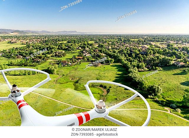 drone flying over prairie landscape