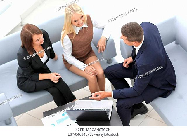 business team discussing financial documents sitting in the lobby of the office. office life
