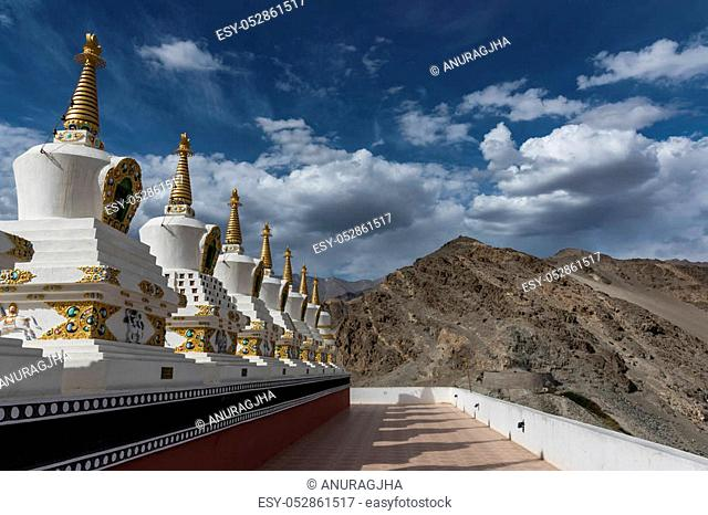 Stupas (chortens) at the highest level of Thiksay monastery complex. Thiksay monastery is a gompa (monastery) affiliated with the Gelug sect of Tibetan Buddhism
