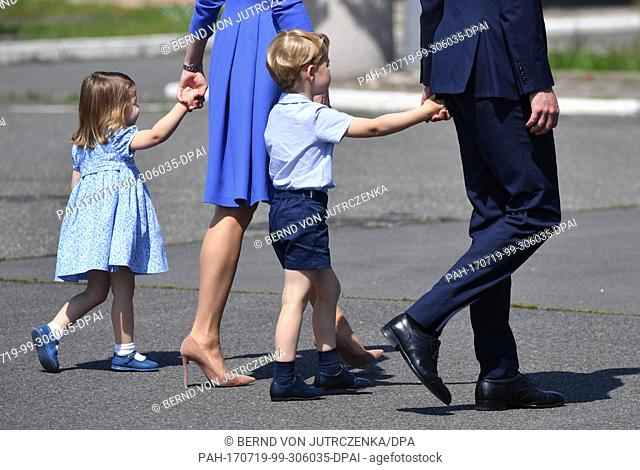 Britain's Prince William (R), his wife Catherine (2-L), Duchess of Cambridge, and their children Prince George(3-L) and Princess Charlotte arrive at Tegel...