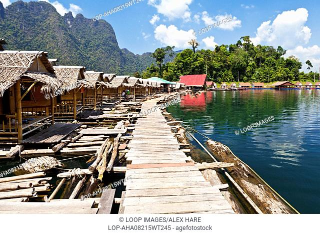 Floating chalets for tourists staying on Cheow Larn Lake in Khao Sok National Park