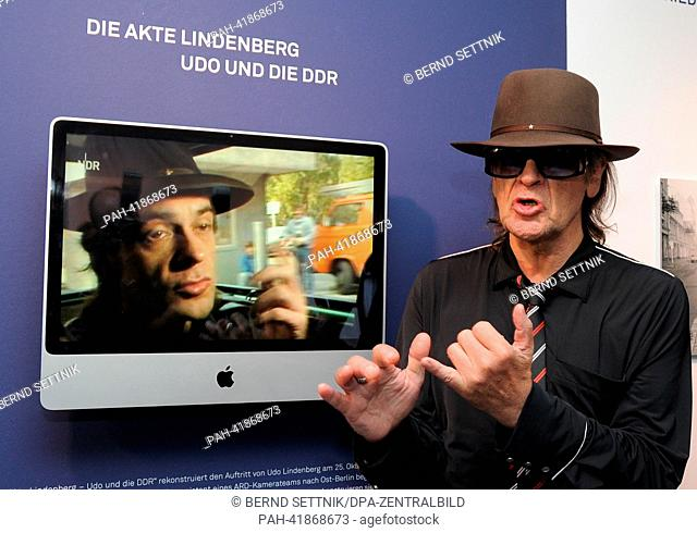 German rock musician Udo Lindenberg stands in front of a screen showing scenes form the Beckmann movie 'The Udo Lindenberg File - Udo and the GDR' at Villa...