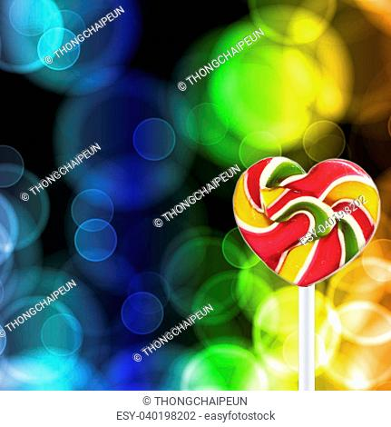 Colorful spiral lollipop on abstract glowing circles background