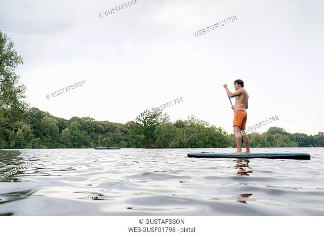 Man on SUP board on a lake