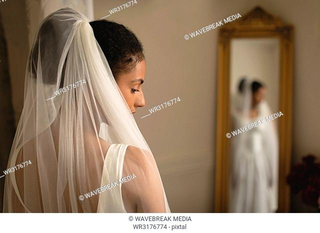 Bride in wedding dress at boutique