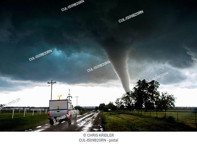 Storm vehicle with the Center for Severe Weather Research driving into the path of tornado with winds of 166 to 175 miles per hour, in Katie, Oklahoma