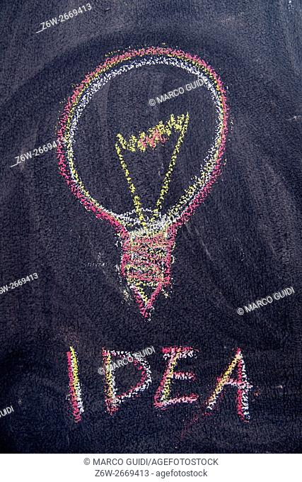 Representation with colored chalk on the blackboard concept of idea