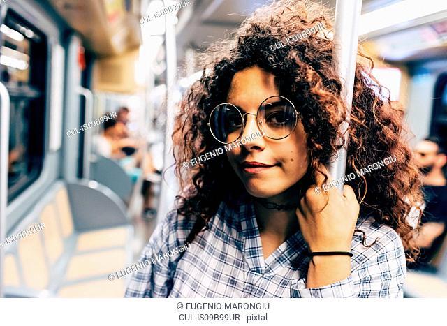 Woman in public transport, Milan, Italy