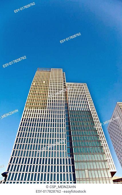 skyscraper in Frankfurt with blue sky and facade in sun