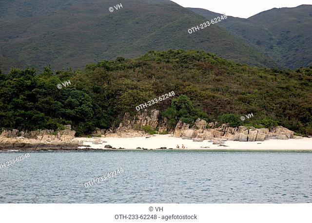 Sand beach and wave erosion rocks at the coast of High Island, off Sai Kung, Hong Kong