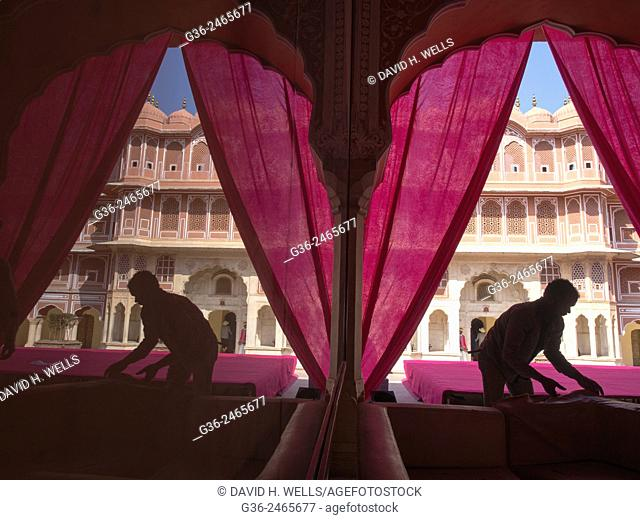 Silhouette of men working in front of Hawa Mahal, Jaipur, Rajasthan, India