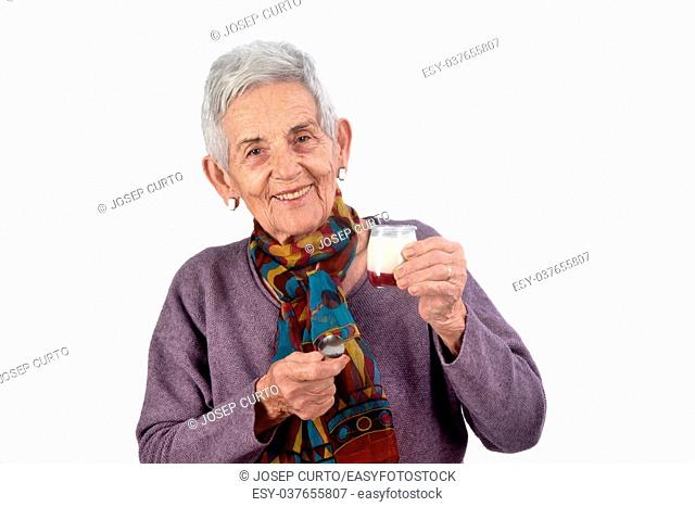 senior woman eating yogurt on white background