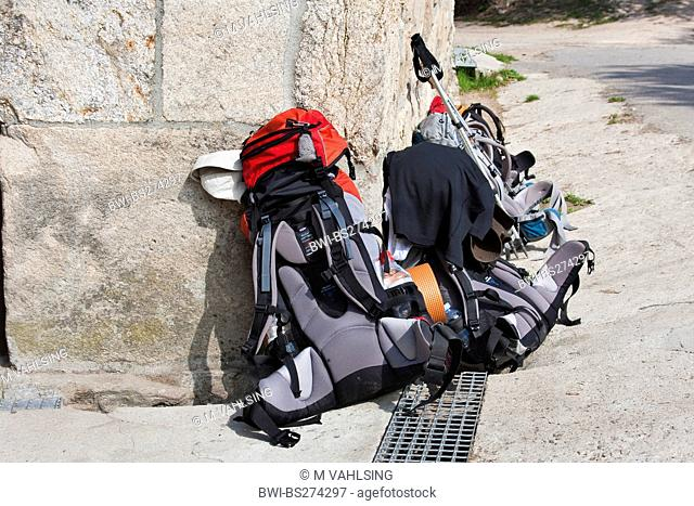 two pilgrim's rucksacks on the road side of Way of St James, Spain, Galicia, Lugo, Morgade