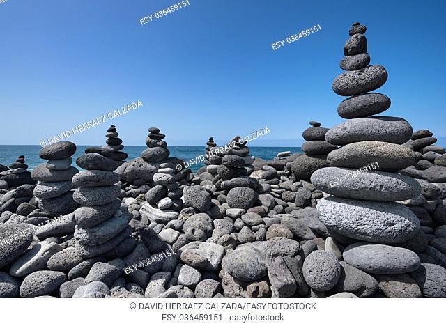 Huge amount of zen stones piled in the beach, Puerto de la Cruz, Tenerife, Spain