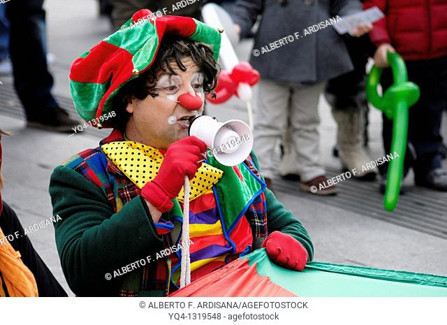 Street performers, Clowns Without Borders in the Puerta del Sol of Madrid. Spain