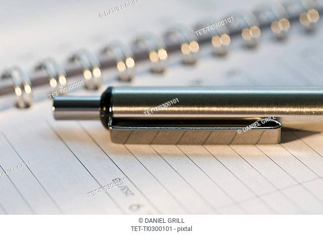 Close up of pen and organizer