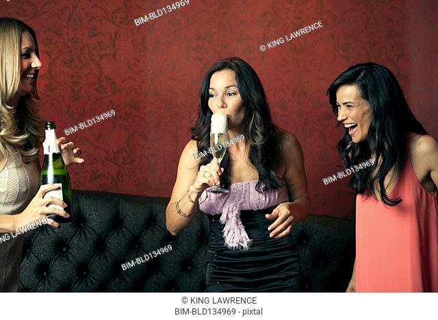 Women drinking champagne in nightclub