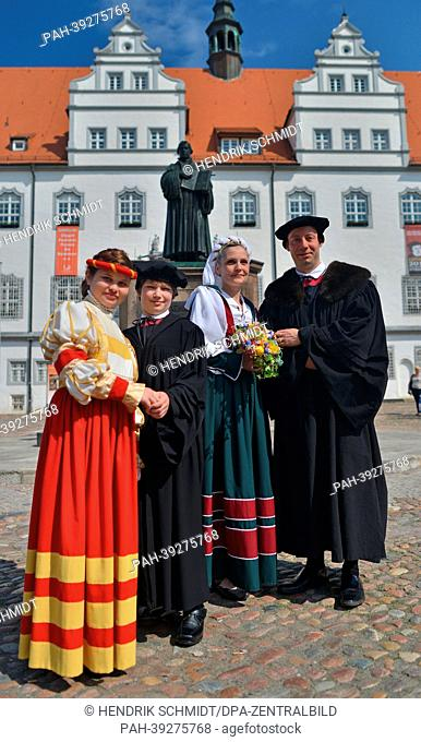The actors for Luther's wedding, Arne Lietz (R) and Katja Wartmann (2-R), as well as the young Luther couple Josefine Hein and Fabian Matthes pose in the market...