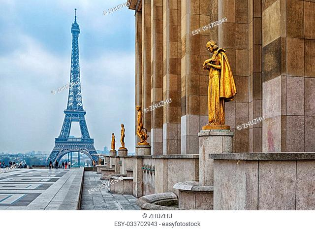 view from Trocadero with golden statues on Eiffel tower, Paris