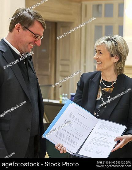 14 October 2021, Saxony, Leipzig: Roland Wöller (CDU), Minister of the Interior of Saxony, and Karola Wille, Director-General of Mitteldeutscher Rundfunk (MDR)