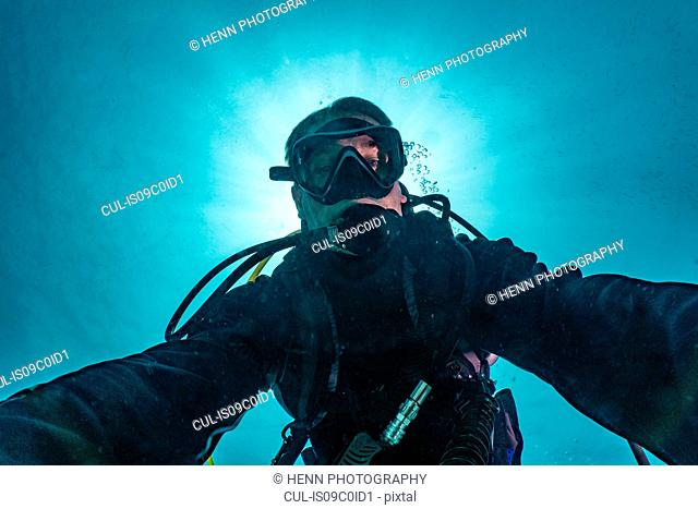 Diver taking selfie, Ko Racha Yai, Rawai, Phuket, Thailand