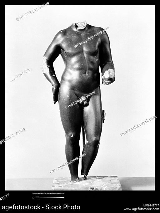 Statue of a boy. Period: Early Imperial; Date: 1st century A.D; Culture: Roman; Medium: Bekhen stone; Dimensions: H. 21 3/4 in. (55