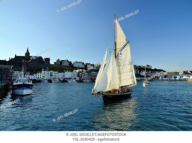 Lys noir (French classic yacht. Rig: yawl auric, 1914) leaving the fishing port of Granville (Normandy, France)