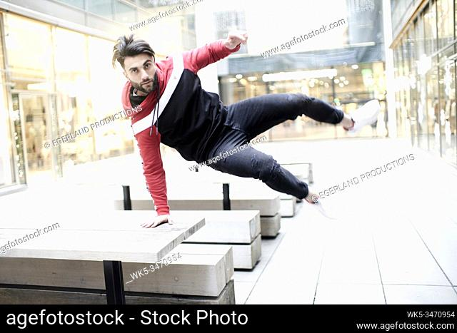 cool man jumping over table