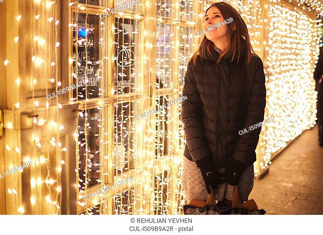 Woman by curtain of fairy lights smiling, Odessa, Odessa Oblast, Ukraine, Europe