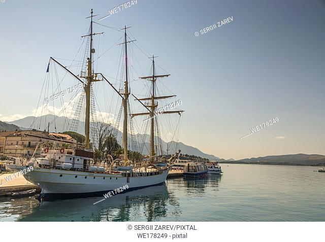 Cruise ship in sea port, Embankment of Tivat city, Montenegro, in a sunny summer day